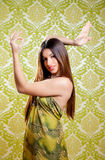 Asian Indian brunette girl with long hair dancing Stock Photo