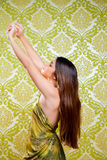 Asian Indian brunette girl with long hair dancing Stock Photography