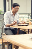 Asian Indian business man reading newspaper Stock Photo