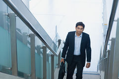 Asian Indian businessman ascending steps Royalty Free Stock Photo