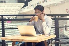 Asian Indian businessman using laptop computer Stock Images