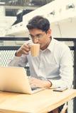 Asian Indian businessman using laptop computer Stock Photos