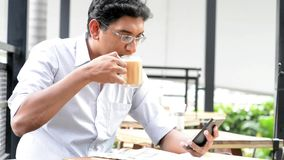 Indian businessman drinking tea stock video