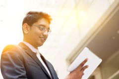 Asian Indian businessman using tablet computer Stock Photo