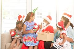 Asian Indian family celebrating Christmas holiday royalty free stock images
