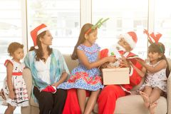 Asian Indian family and Merry Christmas stock image