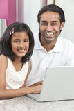 Asian Indian Father & Daughter Using Laptop Stock Photography