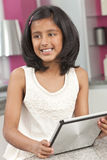 Asian Indian Girl Child Using Tablet Computer Stock Photography