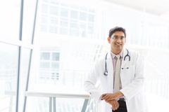Asian Indian male medical doctor . Portrait of a smiling Asian Indian male medical doctor standing inside hospital royalty free stock photography