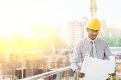Asian Indian male site contractor engineer inspecting at site Royalty Free Stock Photo