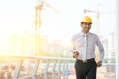 Asian Indian male site contractor engineer walking Stock Photography