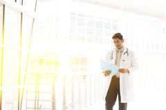 Asian Indian medical doctor walking at hospital corridor Stock Photo