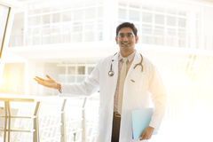 Asian Indian medical doctor welcome hand sign Stock Photos