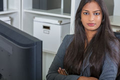 Asian Indian Woman or Businesswoman in Office Royalty Free Stock Image