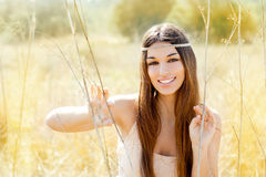 Asian indian woman portrait in golden autumn field Royalty Free Stock Images