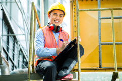 Asian Indonesian construction worker on building site Stock Photography