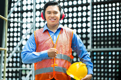 Asian Indonesian construction worker on building site Stock Image