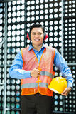 Asian Indonesian construction worker on building site Stock Photo