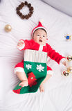 Asian Infant Baby in santa costume christmas celebration on white Royalty Free Stock Photos