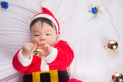 Asian Infant Baby in santa costume christmas celebration on white Stock Images