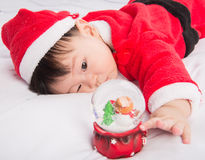Asian Infant Baby in santa costume christmas celebration on white Stock Photos