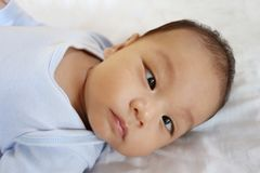 Asian Infant on a bed in face focus. Concept of healthy growth stock photo