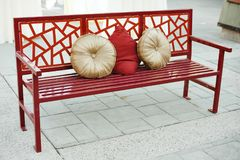 Asian inspired bench with pillows stock photos