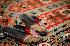 Asian interior. Carpet and slippers Royalty Free Stock Photo