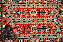 Asian interior. Carpet and slippers Royalty Free Stock Image