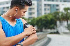 Asian jogger with sports armband Stock Images