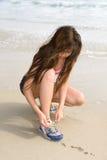 Asian jogger tying shoe Royalty Free Stock Image