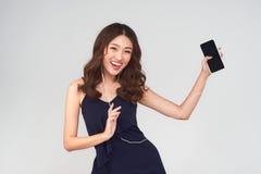 Asian joyful asian woman listening to music.  Stock Photo