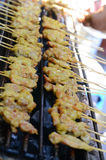 Asian kebab satay. The cooking is done outside the restaurants, a good gimmick to attract customers Royalty Free Stock Image