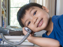 Asian kid amking phone call stock images