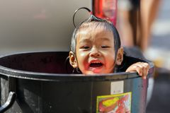 Asian kid bathing in plastic bin Royalty Free Stock Photos