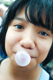 Asian kid blowing a bubble gum Stock Images