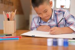 Asian kid boy child schoolboy drawing picture. children activity. Little asian kid boy child schoolboy drawing picture. children leisure activity at home stock image