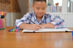 Asian kid boy child schoolboy drawing picture. children activity. Little asian kid boy child schoolboy drawing picture. children leisure activity at home stock photography