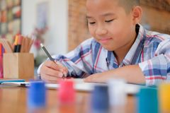 Asian kid boy child schoolboy drawing picture. children activity. Little asian kid boy child schoolboy drawing picture. children leisure activity at home stock images