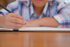 Asian kid boy child schoolboy drawing picture. children activity. Little asian kid boy child schoolboy drawing picture. children leisure activity at home royalty free stock photo