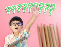 Asian Kid boy raising hand for question. Asian Kid boy raising hand for a question Stock Images