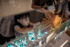 Asian kid choosing earrings with her mother stock photo
