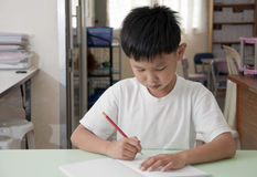 Asian kid in class room Royalty Free Stock Photo