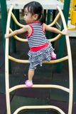 Asian Kid Climbing Royalty Free Stock Photo