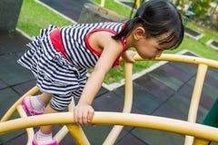 Asian Kid Climbing Royalty Free Stock Images