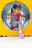 Asian Kid Crawling on Playground Tube Royalty Free Stock Photos