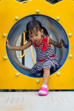 Asian Kid Crawling on Playground Tube Stock Photography