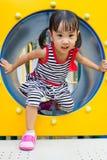 Asian Kid Crawling on Playground Tube Royalty Free Stock Images