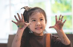 Asian kid with dirty painted hand in art classroom. Asian kids with dirty painted hand in art classroom stock photo