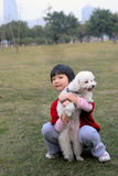 Asian kid and dog Royalty Free Stock Photography
